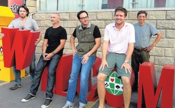 The Double Dummy production team poses outside the playing site in Taicang, China. From left are Derek Sieg, producer; Darin Moran, director of photography; Lucas Krost, director; John McAllister, producer; and Liming Fan, sound man.